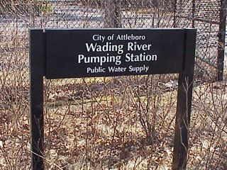 "A sign reading ""Wading River Pumping Station."""